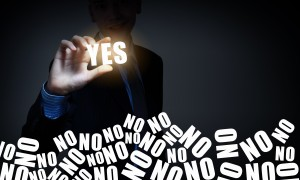 Hand of businessman taking word yes with fingers