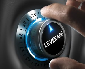 Leverage button pointing x10 position with two fingers, blue and grey tones, Conceptual image for day trading strategy.