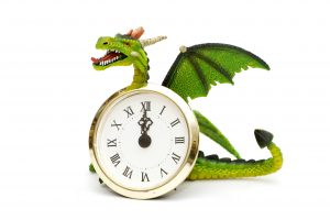 Dragon and clocks isolated on white background