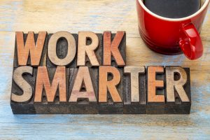 work smarter advice - words in vintage letterpress wood type blocks stained by color inks with a cup of coffee